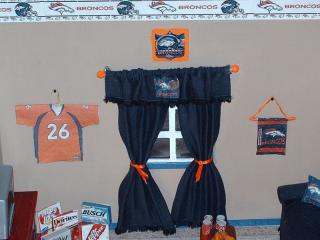11. showing the jersey and clock and wall hanging.JPG