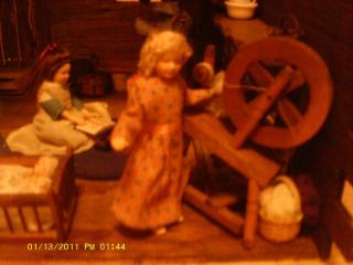 Mary at the spinning wheel