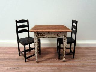 Aged kitchen table and chairs