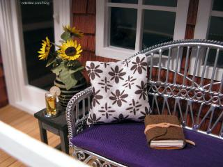 Porch settee, journal and flowers