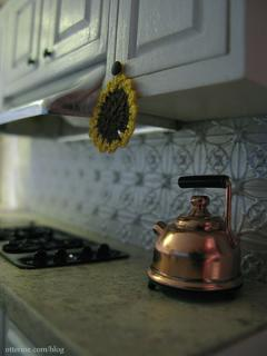 Sunflower potholder and kettle