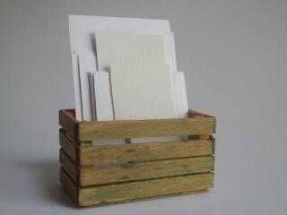 Canvas sheets in a crate