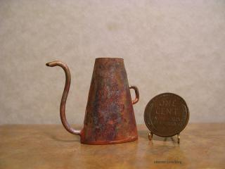 Aged copper watering can