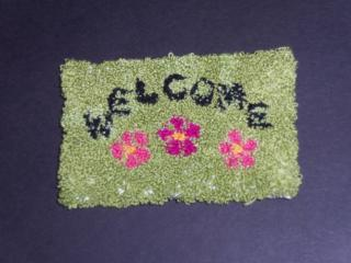 Punch needle welcome mat