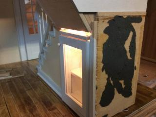 Lighted display cabinet under the stairs