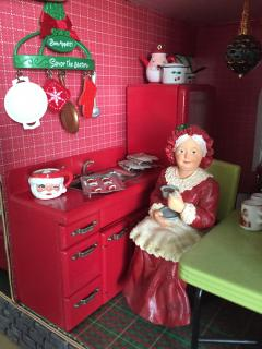 Mrs Claus viewing her new Utensil Rack and Santa Head Tureen