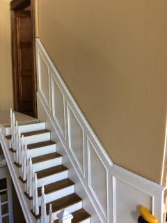 The angeled wainscoting.