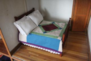 Bed in parents' bedroom